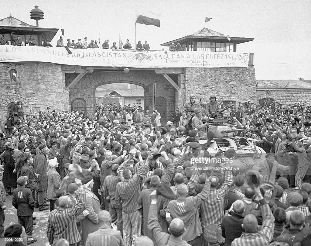 Tanks of us 11th armoured division entering the mauthausen tanks of us 11th armoured division entering the mauthausen concentration camp banner in spanish reads m4hsunfo