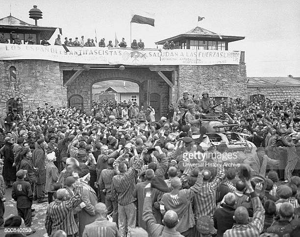 Tanks of US 11th Armoured Division entering the Mauthausen concentration camp banner in Spanish reads Antifascist Spaniards greet the forces of...