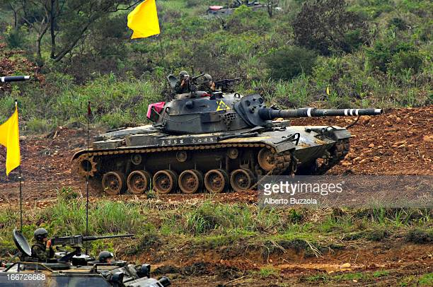 Tanks rolling over the rough terrain of Hukou Army base where the ROC military holds the Han Guang 23 Exercise to show their military preparedness As...