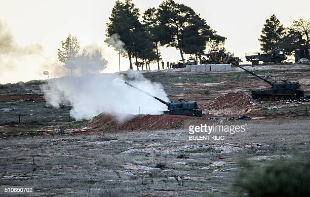 Tanks stationed at a Turkish army position near the Oncupinar crossing gate close to the town of Kilis south central Turkey fire towards the Syria...