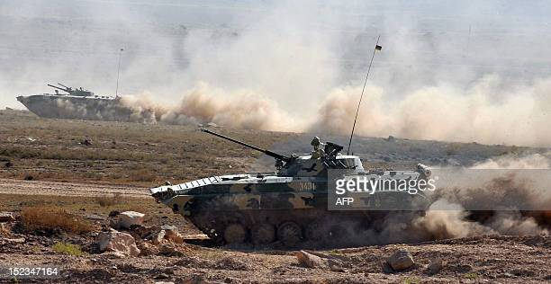 Tanks take part in a military exercise at the Marshal Bagramian training grounds near the ArmeniaTurkey border in Armenia on September 19 2012 Around...