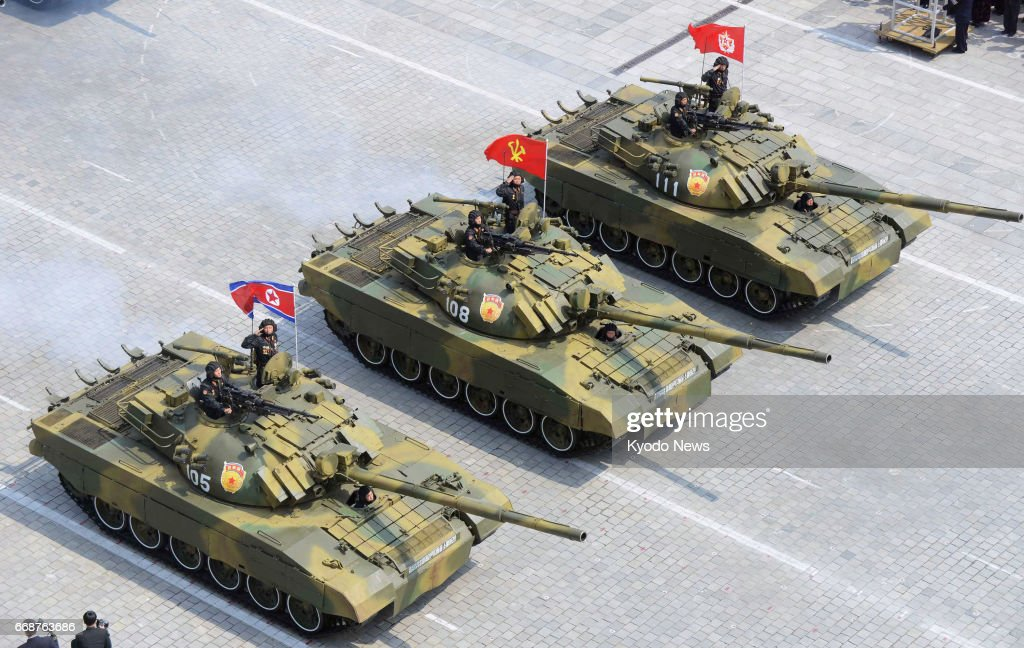 tanks-take-part-in-a-military-parade-at-kim-il-sung-square-in-on-15-picture-id668763686