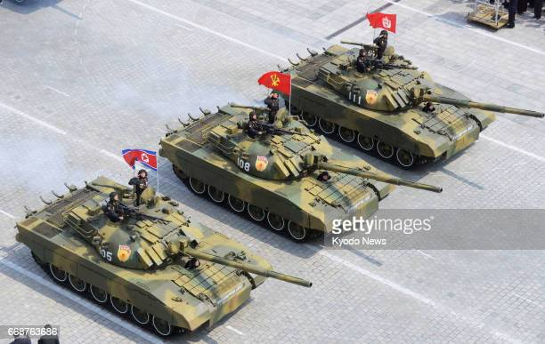 Tanks take part in a military parade at Kim Il Sung Square in Pyongyang on April 15 as North Korea marked the 105th anniversary of its founding...