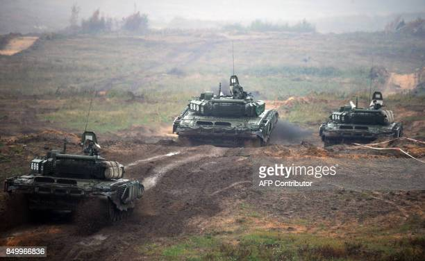 Tanks take part in the joint RussianBelarusian military exercises Zapad2017 at a training ground near the town of Borisov on September 20 2017 / AFP...