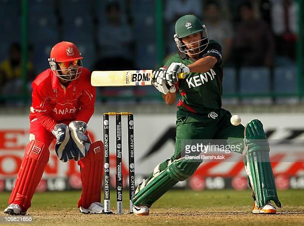 Tanmay Mishra of Kenya bats as captain Ashish Bagai of Canada keeps wicket during the ICC Cricket World Cup group A match between Canada and Kenya at...