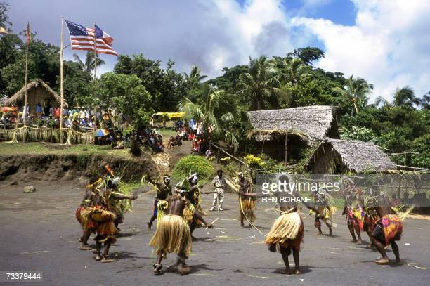 Vanuatu-US-cult-religion,sched-FEATURE This photo taken 15 February, 2006 shows dancers celebrating the anniversary of the John Frum Movement cargo...