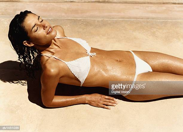 Tanned Woman Lying Sunbathing With Her Eyes Closed