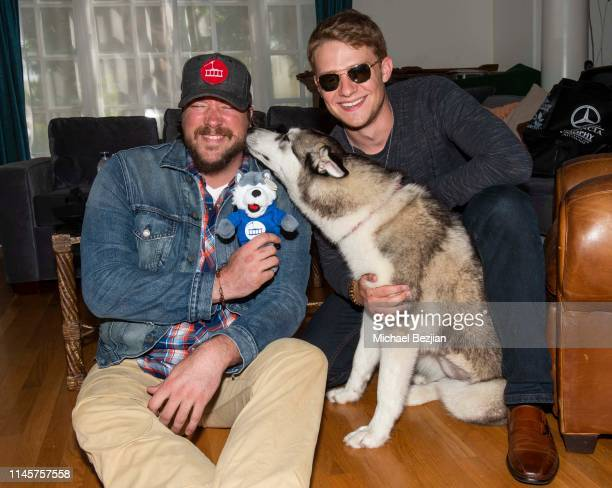 Tanner Beard and Lou Wegner with Luna the Husky attend Kids Against Animal Cruelty visits TAP The Artists Project on April 28 2019 in Los Angeles...