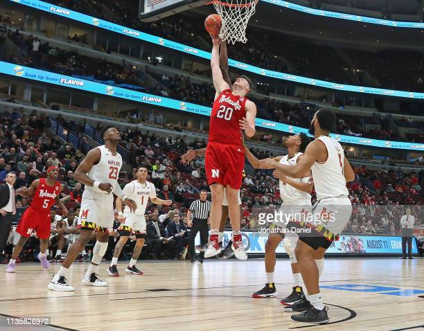 Tanner Borchardt of the Nebraska Cornhuskers rebounds over Aaron Wiggins and Eric Ayala of the Maryland Terrapins at the United Center on March 14...