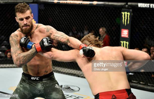 Tanner Boser and Daniel Spitz trade punches in their heavyweight bout during the UFC Fight Night event at TD Garden on October 18, 2019 in Boston,...