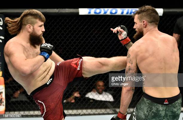 Tanner Boser kicks Daniel Spitz in their heavyweight bout during the UFC Fight Night event at TD Garden on October 18, 2019 in Boston, Massachusetts.
