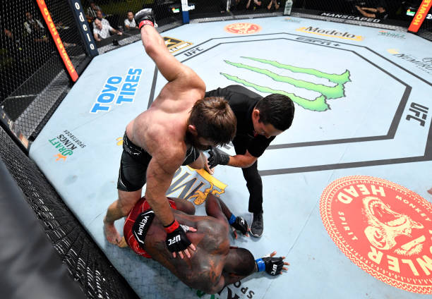 Tanner Boser of Canada punches Ovince Saint Preux in a heavyweight fight during the UFC Fight Night event at UFC APEX on June 26, 2021 in Las Vegas,...
