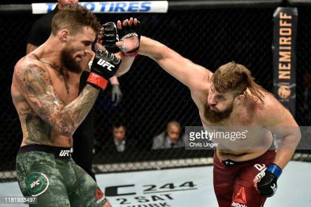 Tanner Boser punches Daniel Spitz in their heavyweight bout during the UFC Fight Night event at TD Garden on October 18, 2019 in Boston,...