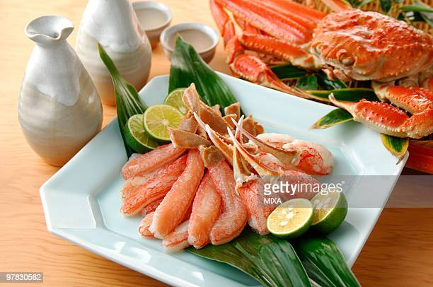tanner crab and sake - chionoecetes opilio stock photos and pictures