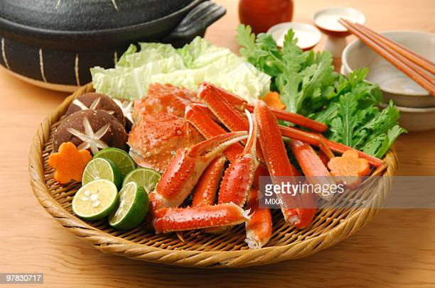 tanner crab hot pot - chionoecetes opilio stock photos and pictures