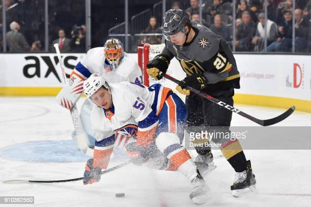 Tanner Fritz of the New York Islanders and Cody Eakin of the Vegas Golden Knights battle for the puck during the game at TMobile Arena on January 25...