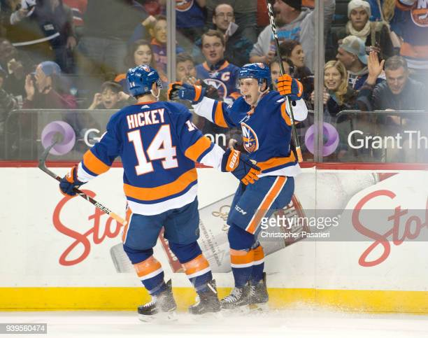 Tanner Fritz of the New York Islanders celebrates his firstperiod goal against the Montreal Canadiens with teammate Thomas Hickey at Barclays Center...