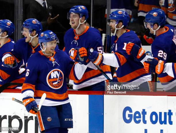Tanner Fritz of the New York Islanders celebrates scoring his first NHL goal in an NHL hockey game against the Minnesota Wild at Barclays Center on...