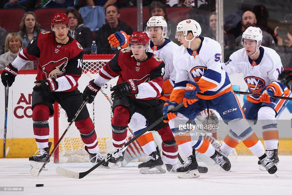 Tanner Fritz #56 of the New York Islanders controls the puck ahead of Clayton Keller #9 of the Arizona Coyotes during the first period of the NHL game at Gila River Arena on January 22, 2018 in Glendale, Arizona. The Coyotes defeated the Islanders 3-2 in overtime.
