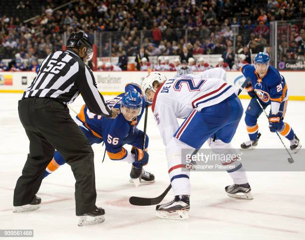 Tanner Fritz of the New York Islanders faces off against Jacob de la Rose of the Montreal Canadiens during the third period at Barclays Center on...