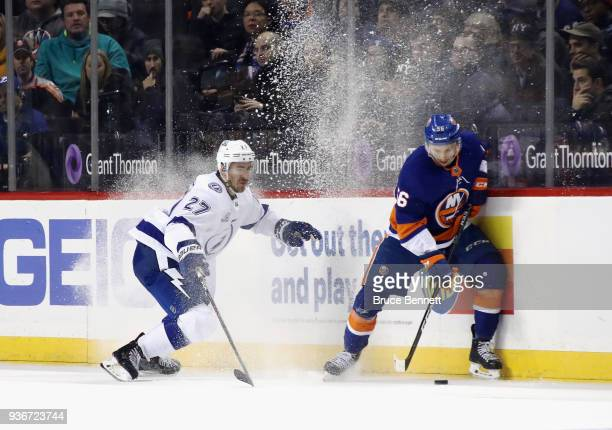 Tanner Fritz of the New York Islanders is checked by Ryan McDonagh of the Tampa Bay Lightning during the third period at the Barclays Center on March...