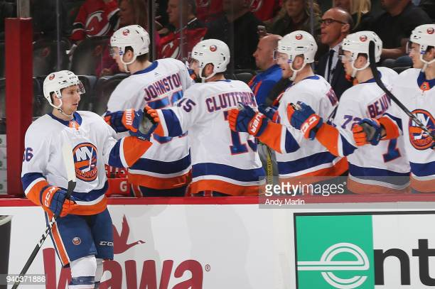 Tanner Fritz of the New York Islanders is congratulated by his teammates after scoring a firstperiod goal against the New Jersey Devils during the...