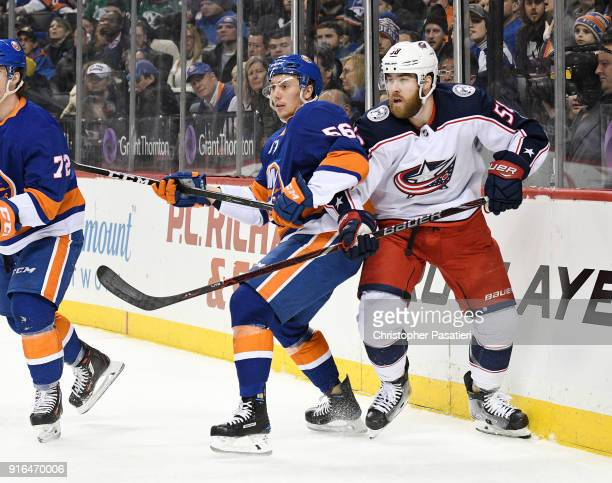 Tanner Fritz of the New York Islanders skates against David Savard of the Columbus Blue Jackets during the first period at Barclays Center on...
