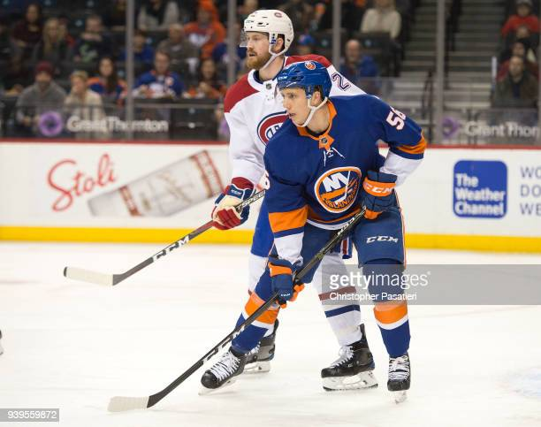Tanner Fritz of the New York Islanders skates against Jeff Petry of the Montreal Canadiens during the first period at Barclays Center on March 2 2018...
