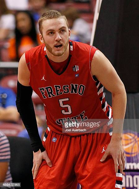 Tanner Giddings of the Fresno State Bulldogs looks on as the Florida Gators bring the ball up court during the MetroPCS Orange Bowl Basketball...