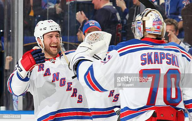 Tanner Glass and Mackenzie Skapski of the New York Rangers celebrate their 20 victory against the Buffalo Sabres on March 14 2015 at the First...