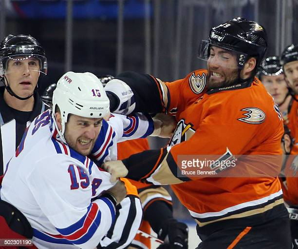 Tanner Glass of the New York Rangers fights with Patrick Maroon of the Anaheim Ducks during the first period at Madison Square Garden on December 22,...