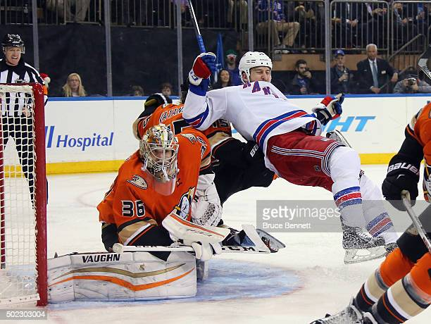 Tanner Glass of the New York Rangers is tripped up in front of John Gibson of the Anaheim Ducks during the second period at Madison Square Garden on...