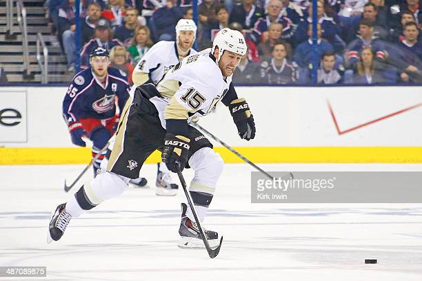 Tanner Glass of the Pittsburgh Penguins controls the puck during Game Four of the First Round of the 2014 NHL Stanley Cup Playoffs against the...