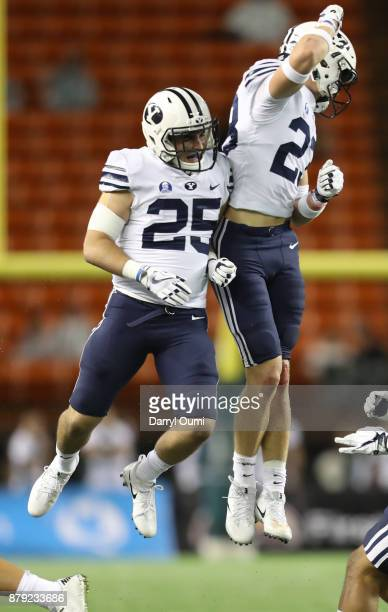 Tanner Jacobson and Zayne Anderson of the BYU Cougars celebrate after a touchdown during the second half of the game against the Hawaii Rainbow...