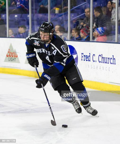 Tanner Jago of the Bentley Falcons skates against the Massachusetts Lowell River Hawks during NCAA men's hockey at the Tsongas Center on November 28...