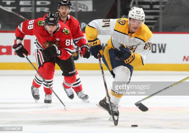 Tanner Jeannot of the Nashville Predators controls the puck in front of Patrick Kane of the Chicago Blackhawks in the second period at United Center...