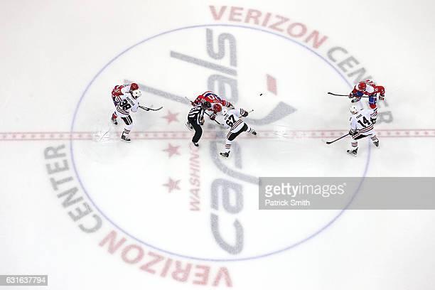 Tanner Kero of the Chicago Blackhawks and Lars Eller of the Washington Capitals faceoff at Verizon Center on January 13 2017 in Washington DC
