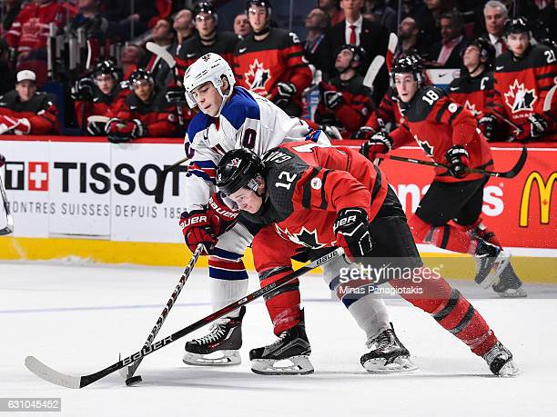 Tanner Laczynski of Team United States and Julien Gauthier of Team Canada battle for the puck during the 2017 IIHF World Junior Championship gold...