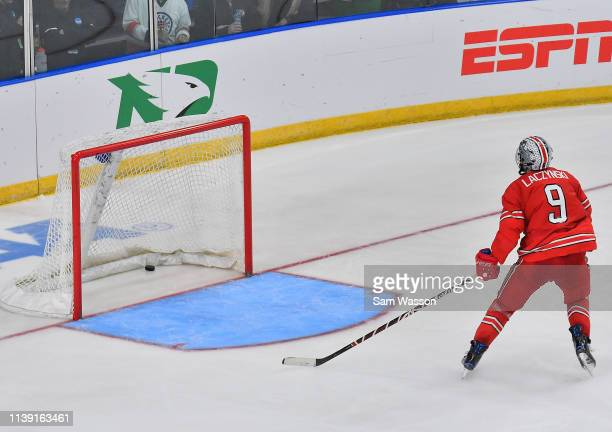 Tanner Laczynski of the Ohio State Buckeyes looks at the puck after Colin Staub of the Denver Pioneers scored an empty net goal in the third period...