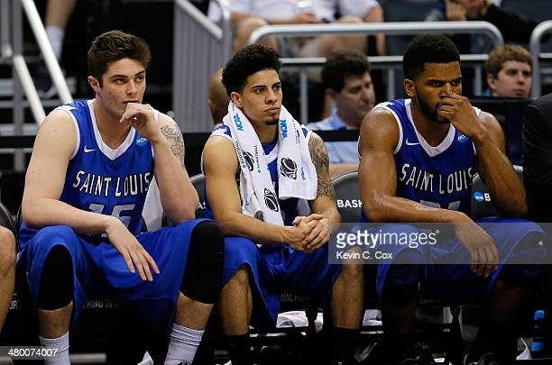Tanner Lancona Austin McBroom and Dwayne Evans of the Saint Louis Billikens on the bench late in the second half against the Louisville Cardinals...