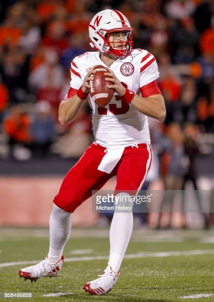 Tanner Lee of the Nebraska Cornhuskers drops back to throw against the Illinois Fighting Illini at Memorial Stadium on September 29 2017 in Champaign...