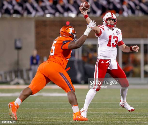 Tanner Lee of the Nebraska Cornhuskers drops back to throw during the game against the Illinois Fighting Illini at Memorial Stadium on September 29...