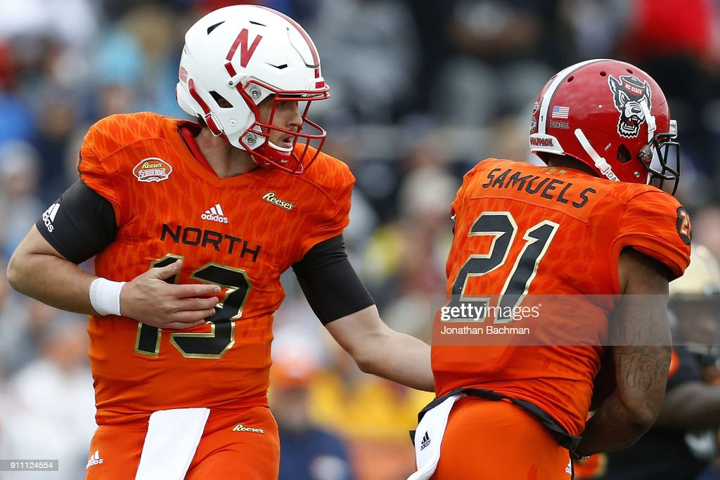 Tanner Lee #13 of the North team hands the ball to Jaylen Samuels #21 during the first half of the Reese's Senior Bowl against the the South team at Ladd-Peebles Stadium on January 27, 2018 in Mobile, Alabama.