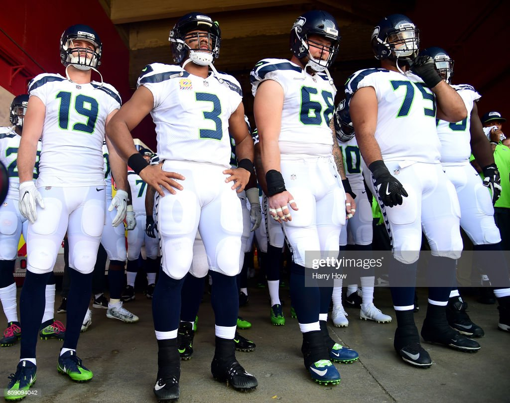 Tanner McEvoy #19, Russell Wilson #3, Justin Britt #68 and Oday Aboushi #75 of the Seattle Seahawks wait to get on the field before the game against the Los Angeles Rams at Los Angeles Memorial Coliseum on October 8, 2017 in Los Angeles, California.