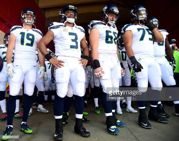 Tanner McEvoy Russell Wilson Justin Britt and Oday Aboushi of the Seattle Seahawks wait to get on the field before the game against the Los Angeles...