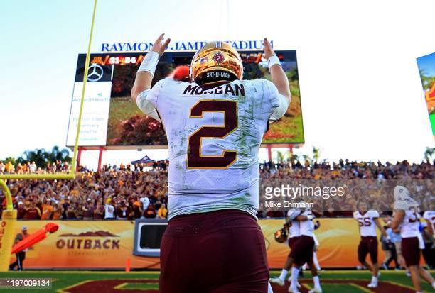 Tanner Morgan of the Minnesota Golden Gophers celebrates after winning the 2020 Outback Bowl against the Auburn Tigers at Raymond James Stadium on...