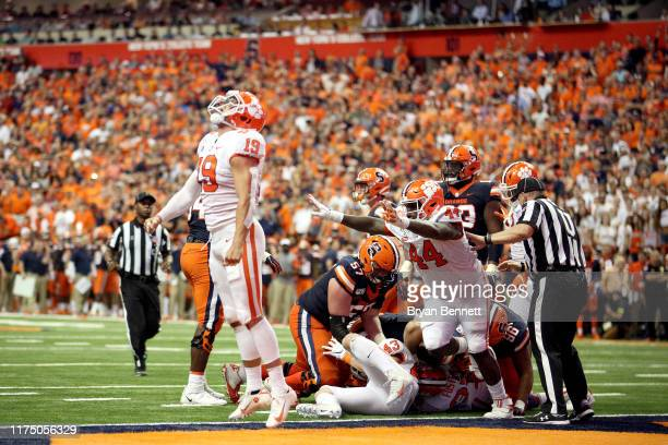 Tanner Muse and teammate Nyles Pinckney of the Clemson Tigers react after making a play during a game against the Syracuse Orange at the Carrier Dome...