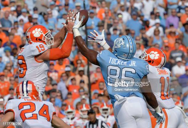 Tanner Muse of the Clemson Tigers breaks up a pass intended for Carl Tucker of the North Carolina Tar Heels during the first half of their game at...
