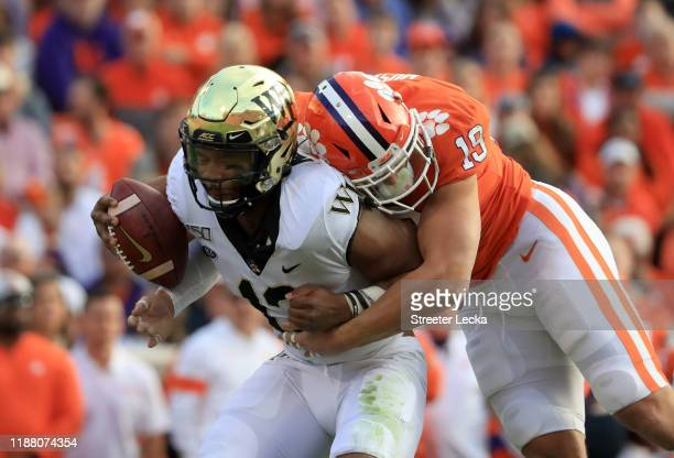 Tanner Muse of the Clemson Tigers sacks Jamie Newman of the Wake Forest Demon Deacons during their game at Memorial Stadium on November 16 2019 in...