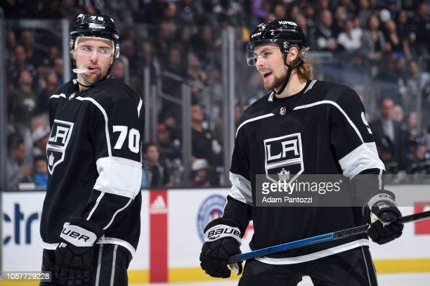Tanner Pearson and Adrian Kempe of the Los Angeles Kings talk during the first period of the game against the Buffalo Sabres at STAPLES Center on...
